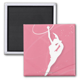 Silhouette of a female gymnast performing with a magnet