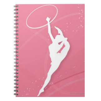 Silhouette of a female gymnast performing with a notebook