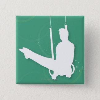 Silhouette of a man performing gymnastics 15 cm square badge