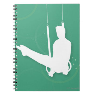 Silhouette of a man performing gymnastics notebook