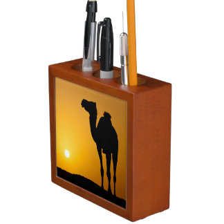 Silhouette of a wild camel at sunset desk organiser