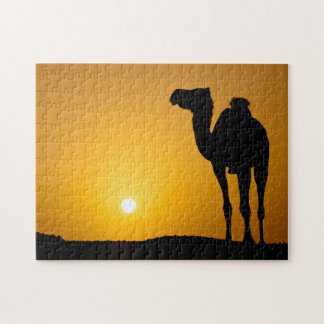 Silhouette of a wild camel at sunset puzzles