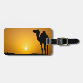 Silhouette of a wild camel at sunset tag for luggage
