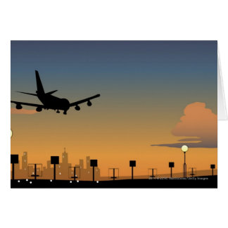 Silhouette of an airplane in flight greeting card