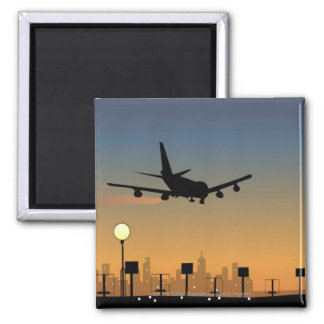 Silhouette of an airplane in flight square magnet