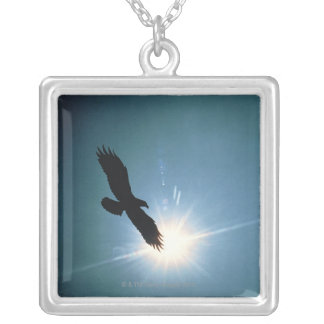 Silhouette of bald eagle flying in sky silver plated necklace