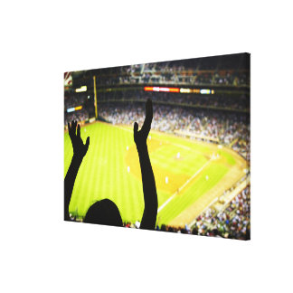 Silhouette of Baseball fan waving hands in the Canvas Prints