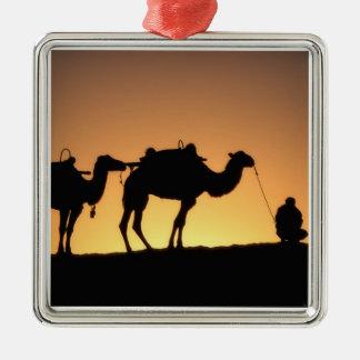 Silhouette of camel caravan on the desert at 2 christmas ornament