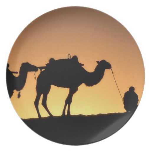 Silhouette of camel caravan on the desert at 2 plates