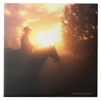 Silhouette of cowboy on a horse large square tile