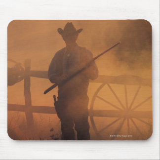 Silhouette of cowboy with rifle in hand mouse mat