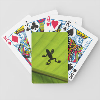 Silhouette of frog through banana leaf bicycle playing cards