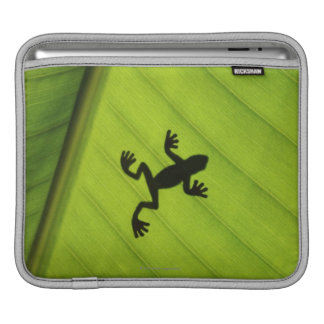 Silhouette of frog through banana leaf iPad sleeve