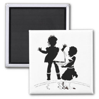 silhouette of girl and boy and model boat magnet