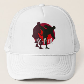Silhouette of Karate fight, red circle background. Cap