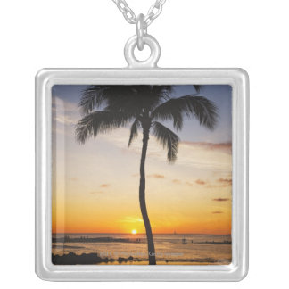 Silhouette of one Palm Tree by a Red Orange Sunset Silver Plated Necklace