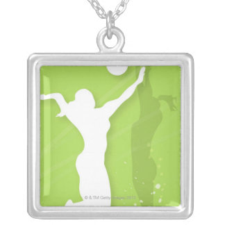 Silhouette of two women playing volleyball pendant