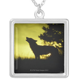 Silhouette of wolf howling silver plated necklace