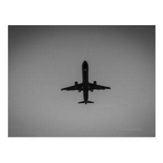 Silhouetted aircraft landing postcard