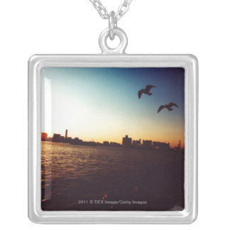 Silhouetted Tokyo Bay skyline at sunset Silver Plated Necklace