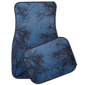Silhouetted trees at twilight car mat