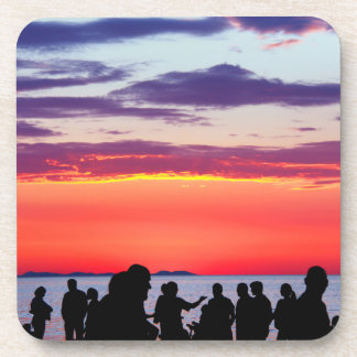 Silhouettes in the sunset drink coaster