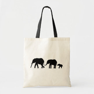 Silhouettes of 3 Elephants Holding Tails Tote Bag