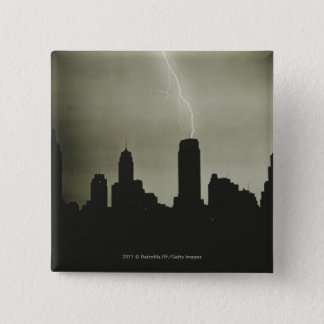 Silhouettes of skyscrapers and lightning in sky 15 cm square badge