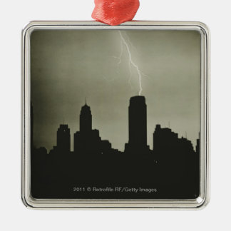 Silhouettes of skyscrapers and lightning in sky christmas ornament