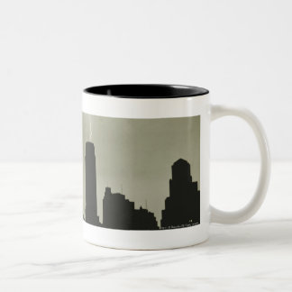 Silhouettes of skyscrapers and lightning in sky Two-Tone coffee mug