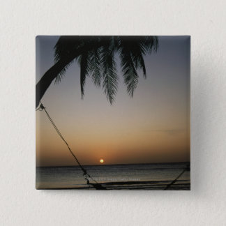 Silhuetted empty hammock at sunset 15 cm square badge