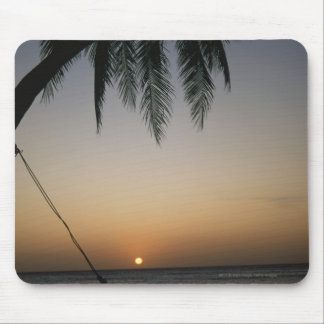 Silhuetted empty hammock at sunset mouse mat