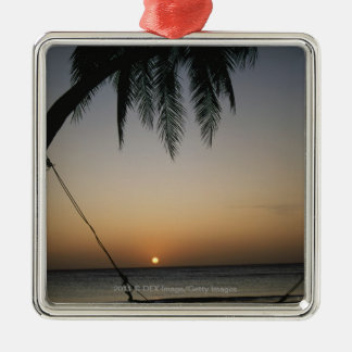 Silhuetted empty hammock at sunset Silver-Colored square decoration