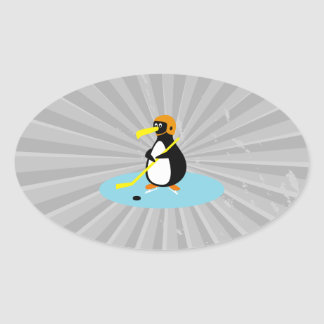 silly cute ice hockey penguin oval sticker