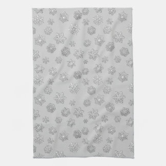 Silver 3-d snowflakes on a silver background tea towel