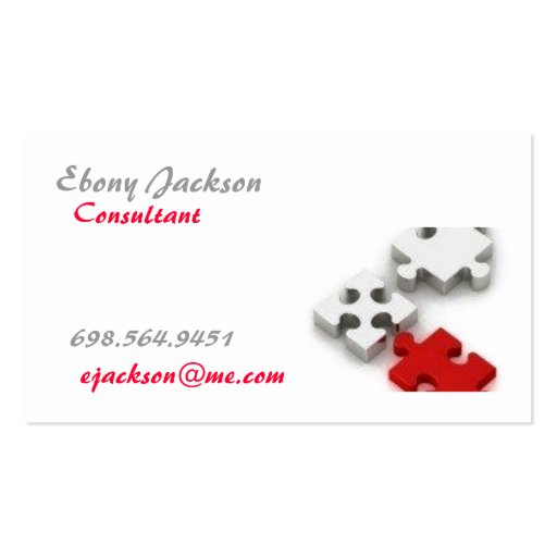 Silver and red puzzle pieces business card