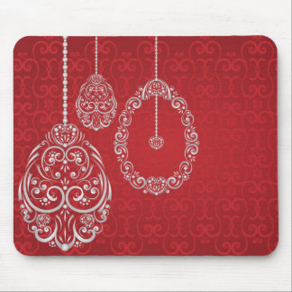 Silver hanging Easter eggs against a rich red back Mousepads