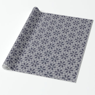 Silver lace floral stars on dark blue wrapping paper
