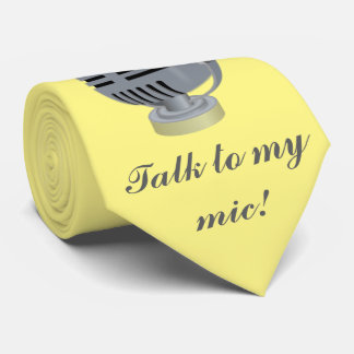 Silver microphone, Music. Yellow background. Tie