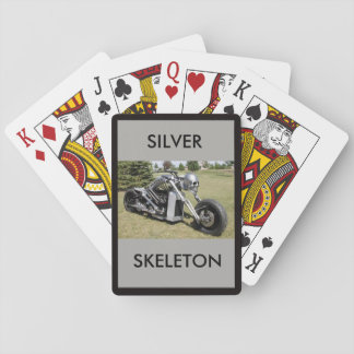 Silver Skeleton motorcycle on a deck of cards