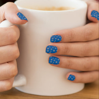 Silver snowflakes on a cobalt blue background  	Minx® nail art