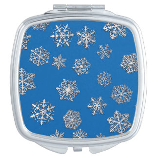 Silver snowflakes on a cobalt blue background compact mirrors