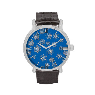 Silver snowflakes on a cobalt blue background wristwatches