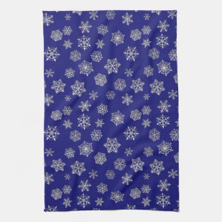Silver snowflakes on a dark blue background tea towel