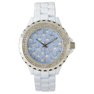 Silver stars, on pale blue wrist watches