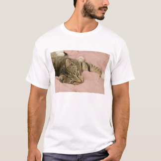Silver tabby stretched out on bedspread T-Shirt