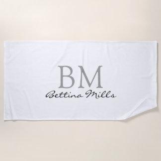 simple monogram on white beach towel