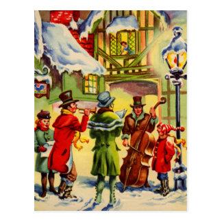 Singing Christmas Carols on a Snowy Evening Postcard