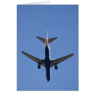 Single airplane on the blue sky background card