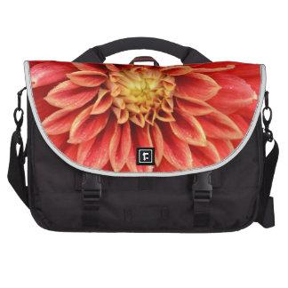 Single orange dahlia flower laptop bag